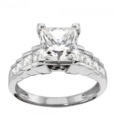 This engagement ring is fit for a princess. The substantial staircase band glitters with eight accents flanking the Contemporary Nexus Diamond™ center stone, creating a modern look with more than a dash of romance.  Center stone pictured: 2.40 carat Princess cut, 3.14tcw (1.24 Princess cut center stone on hand) Center stone is available in a variety of carat weights; choose yours from the menu above. Eight Princess cut Nexus Diamond accents Complete the look with the matching Cinderella…