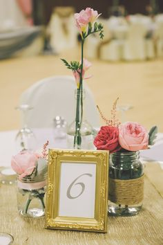 rustic rose and gold picture frame table number http://www.weddingchicks.com/2013/10/02/family-farm-wedding/