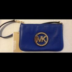 "NWT Michael Kors stunning blue leather wristlet! NWT Michael Kors stunning blue leather wristlet!!!!! Gorgeous soft fulton blue leather, this wristlet is truly a stunner!!  Measures 7"" in length & 4 1/2"" in height Michael Kors Bags"