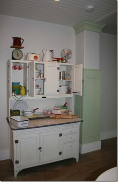Cute decorating of a Hoosier cabinet