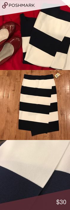 "Navy and white striped skirt Classic nautical look in this stretchy navy and white striped skirt by INC. viscose, nylon, and spandex blend it has an asymmetrical styling. Size medium with elastic waist it measures approx 26"" in length. NWT INC International Concepts Skirts Asymmetrical"