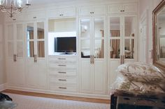 Master bedroom built-in closet - traditional - closet - by Covenant Millwork Inc.