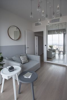 Ghost sofa compliant with neutral-pallette appartment in Warsaw by interior designer Zofia Wyganowska. Accompanied by Gervasoni's Gray side tables. All available at Showroom MOOD, Warsaw #mood #gervasoni #sofa #greysofa #grey