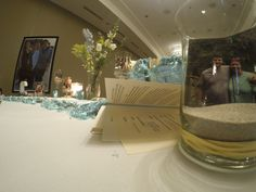 Special decor, incorporating a beachy theme and photos at a Celebration of Life memorial www.eternallyloved.com