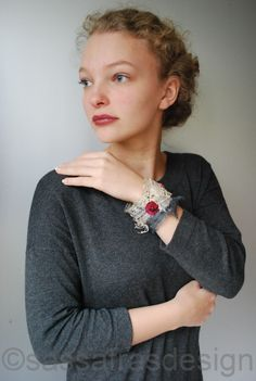 Grey dress, handmade cuff  Fiber art by Claudia Burkhardt Model: Irthe Zandstra