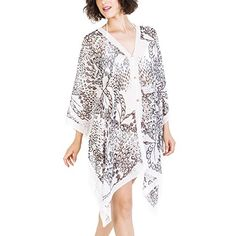Melifluos Summer Swimwear Cover-up Pareo:Beachwear Scarf Sarong for Bikini 1001 BlackWhite OS. MELIFLUOS is a Spanish design brand based in Los Angeles whose goal is to offer products that combines the elegance of European design with the dynamics of California. The material is soft, light, comfortable and breathable. Additionally, the dress creates an illusion of stunning curves. Are you ready to be the spot light of the beach and pool?. The patterns and prints are created by our design…