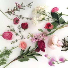 Small arrangement in vessel of designer's choice Flowers could include: garden roses, ranunculus, berries, leucadendron, coxcomb, anemone, protea, stock, tulips, hellebores, sweet peas, astilbe, scabi
