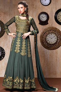 Green Georgette Churidar Suit with Chiffon Dupatta Price: £85.00 Green Georgette, semi stictch anarkali churidar suit.   U neck, Floor length, full sleeves kameez.   Green santoon churidar.   Green chiffon dupatta with lace border with work.  It is perfect for casual wear, party wear and wedding wear wear.  Andaaz Fashion is the most popular designer wear online ethnic shop brands  http://www.andaazfashion.co.uk/green-georgette-churidar-suit-with-chiffon-dupatta-22870.html