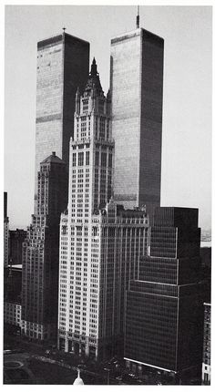the woolworth building looking southwest from municipal building showing the twin towers of world trade center april 1983   Flickr - Photo S...