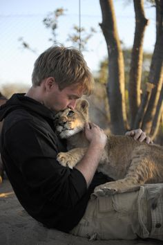 These heart-warming photographs show an incredible bond between a WILD lioness and the men fighting to save her species. The amazing pictures show Sirga — a lioness — and her adopted pride Valentin Gruener and Mikkel Legarth. Animals And Pets, Baby Animals, Cute Animals, Mundo Animal, My Animal, Animal Care, I Love Cats, Big Cats, Man Beast