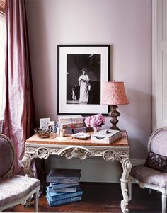 A photo of Ella Fitzgerald hangs above a French desk in this New Orleans home featured on Apartment Therapy.