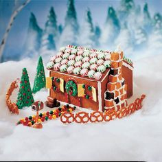 We adapted this pretty gingerbread house from Ellen Wages in Vancleave, Mississippi…and came up with this petite version. Unlike Ellen's larger classroom house, it doesn't need to be constructed around a cardboard shell. —Taste of Home Test Kitchen Christmas Gingerbread House, Gingerbread Houses, Merry Christmas, Gingerbread Cookies, Christmas Cookies, Christmas Decor, Christmas Ideas, Christmas Blessings, Christmas Foods