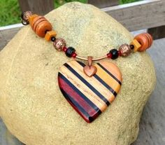 wood hippie jewelry | Natural colour striped heart exotic wood focal bead, mounted on an ...