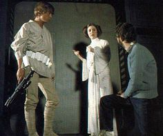 Mark Hamill, Carrie Fisher, and George Lucas on the set of Star Wars.