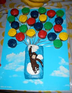 Curious George Cake made using a small loaf pan. I piped George in and then used edible paper for his face for more detail. I connected multi-colored cupcakes with curling ribbon for his balloons. Curious George Cakes, Curious George Party, Curious George Birthday, Birthday Party Games For Kids, 4th Birthday Parties, Birthday Ideas, Balloon Cupcakes, 1st Boy Birthday, Birthday Cake