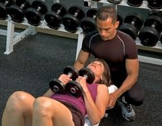 she is learning how to do dumbell bench