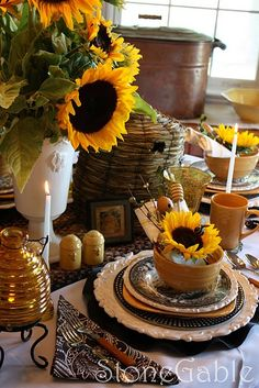 @Nancy Rufle - Oldfather--How about a giant sunflower arrangement in that white pedestal vase we have?