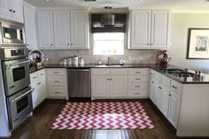 Pretty white kitchen - love dark countertops w/ white cabinets