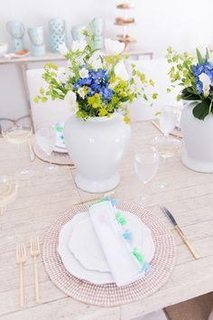 When I think of a simply elegant outdoor tablescape, this display is exactly what comes to mind. Mixing neutrals with pops of blue, accents of golds, and just a bit of texture! I can see myself entertaining with thisdisplay well into the summer. Starting with the place settings… I am in love with the texture of the Kim Seybert Jackson Placemats.They almost resemble sea shells with just a hint of gold! And then topped off withKim Seybert Pom Pom Napkinsthat have amazing bright tassels in…