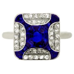 Art Deco Sapphire Diamond Ring ~ a    platinum ring with square bezel set,    one central round old but sapphire     1.00 carats,  36 round diamonds 0.50     c. by Collingwood Court Jewellers      ca. 1925