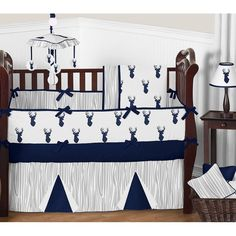 Woodland Deer 9 pc Crib Bedding set has all that your little bundle of joy will need. Let the little one in your home settle down to sleep in this incredible nursery set. This baby boy bedding set features a contemporary stag print, a coordinating wood grain print, and solid navy blue. This collection uses the stylish colors of navy blue, grey, and crisp white. The design uses brushed microfiber fabrics that are machine washable for easy care. This wonderful set will fit all cribs and…