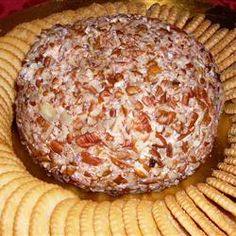 CHEESE BALL RECIPE - makes 1 large cheese ball 2 (8 oz) packagescream cheese, softened 3 1/2 cups shredded sharp Cheddar cheese 1 (1 oz) package Ranch-style dressing mix 2 cups chopped pecans --------------------------------------- Mix cheeses and dressing mix together well.  Form a ball and roll it in chopped pecans.  Refrigerate 2 hrs. or more.