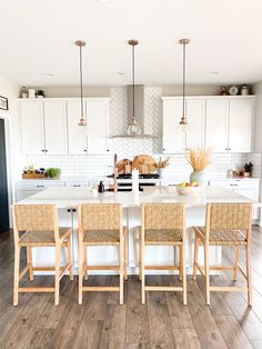 Have you been looking for the perfect boho bar stools for your kitchen island? Click the link to see my round up of all the best and budget friendly boho bar stools from Target, World Market and Walmart! These would also work well with farmhouse style! They are all neutral and perfect with all kitchen styles and colors! #whitekitchen #whitecabinets #whitecounters #subwaytile #whitesubwaytile #subwaytilebacksplash #copperkitchen #copperaccents #blackdoor #diningroom #kitchen Copper Kitchen, Old Kitchen, Kitchen On A Budget, Kitchen Ideas, White Kitchen Decor, White Kitchen Cabinets, Kitchen Island, Contemporary Decor, Modern Decor