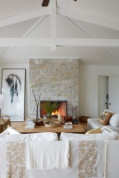 Discover House & Home's Best White Paint Colors – Stone fireplace living room Limestone Fireplace, Home Fireplace, Modern Fireplace, Living Room With Fireplace, Fireplace Design, Living Room Decor, Fireplace Ideas, Traditional Fireplace, Fireplace Remodel
