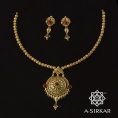 Javmani: A daintily strung Marathi-style serrated-ball har where the imperfection of the gold beads creates a lovely counterpoint to the completely symmetric pendant, this handmade pure 22K gold ornament is no more than ek-bhori (one tola) in weight and is available in three polishes : dull yellow, earthy, and copper dusted. A small ornament that can be very special too.