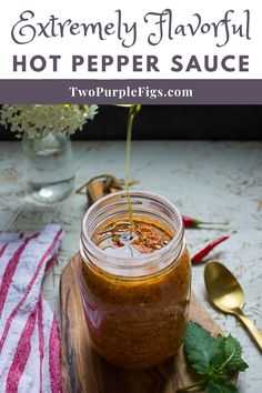 My grandpa's Hot Pepper Sauce is a hot sauce recipe that goes with everything. Everything! Extremely flavorful sauce bursting with hot pepper flavor, and super spicy so proceed at your own risk 🙂 Whipped up in a food processor so no cooking required! #hotsauce #peppersauce #hotpeppersauce #delicious #easyrecipe | twopurplefigs.com @twopurplefigs