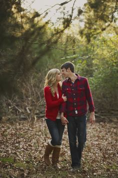 Engagement photo outfits - him: plaid shirt, her: color coordinating cardi
