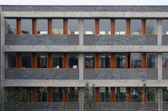 Image 14 of 24 from gallery of Xiaoquan Elementary School / TAO - Trace Architecture Office. Photograph by Yao Li Architecture Office, Architecture Design, Stone Facade, Building Facade, Tao, Elementary Schools, Urban, Gallery, Facades