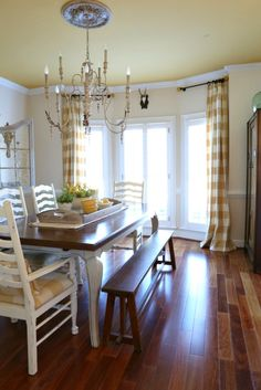 Love the buffalo checks with french pleats drapes in this gorgeous dining room.