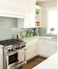 blue green subway tile in white kitchen. I love colored glass subway tile Kitchen Redo, Kitchen And Bath, New Kitchen, Kitchen Remodel, Kitchen Cabinets, Kitchen White, Kitchen Country, Kitchen Countertops, Aqua Kitchen