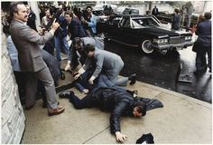 The Reagan assassination attempt occurred on March 30, 1981, at the Washington Hilton Hotel in D.C., when John Hinckley Jr. opened fire on Reagan and three others. After the shooting, Reagan was thrown into the limousine, unaware that he had been shot. He only realized this when he coughed up blood and discovered that his lung had been punctured. 1981