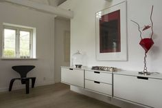 Short E-Tracks allow cabinets to float, only adding to the tranquility