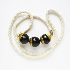 Ivory Mokuba rope and three onix beads