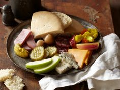 A Ploughman's Lunch — a snack or meal composed of cold ingredients like cheese, meats, butter, fruit, salads, spreads and crusty bread — is a popular item in British pubs, usually served with beer.