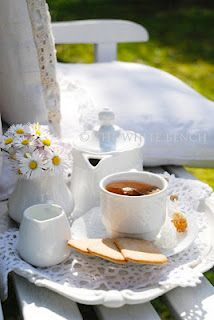 total relaxation...tea, daisies, soft place to land.