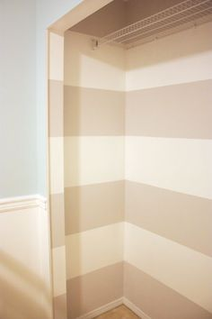 stripes for the closet. seriously greatest idea ever. add a pop to the room without going overboard, make the closet seem bigger and look natural doorless