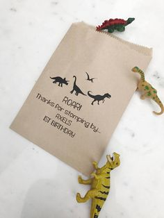 Dinosaur Party Favor Bags! - Kids Birthday Collection - Favor Bags - Custom Printed on Kraft Brown Paper Bags  *QUANTITY • Use the second drop down to see prices & leave the first quantity box at 1*  OUR FAVOR BAGS  •Made from brown kraft paper, dimensions: 5 x 7.5 (12.7cm x 19.05 cm). •We suggest filling these bags with candy, cookies, popcorn, toys, place settings, or unique gifts! | They hold roughly 1-2 cups of goodies when closed. •This bag can be customized with names & age or t...