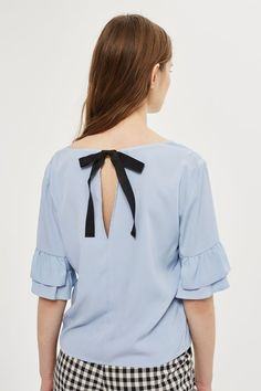 In a barely there blue hue, this floaty top is a versatile style. Boasting ruffle sleeves and a keyhole opening on the back supported by a contrast tie, it's just as suited to office outfits as it is to weekend co-ords. Sexy Outfits, Cute Outfits, Women's Summer Fashion, Office Outfits, Holiday Outfits, Ruffle Sleeve, Topshop, Clothes For Women, How To Wear