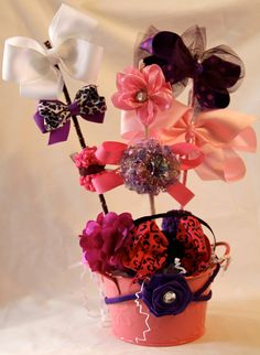 I'm thinking of making this for your shower and it being my gift for Elizabeth, you can use the bows when she's born.