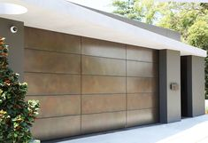 Superb photo - have a look at our article for a whole lot more inspiring ideas! Metal Garage Doors, Garage Door Styles, Garage Door Design, Contemporary Garage Doors, Modern Garage, Contemporary House Plans, Home Gate Design, House Design, Gate House
