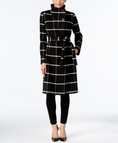 Ivanka Trump's plaid walker coat is deftly designed with an asymmetrical silhouette enhanced by silver-tone buttons at the collar. | Polyester/acrylic/wool/nylon/cotton; lining: polyester | Profession