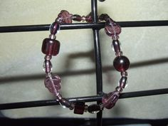 Purple glass leaves and more by LittlebrusBracelets on Etsy, $8.00