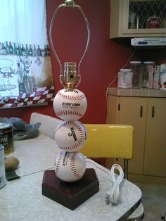 Softball lamp. Made with real softballs. via Etsy