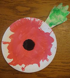 Yesterday morning I did a little poppy craft with Emma in honour of Remembrance Day. She is too young to get the significance of the day, b. Remembrance Day Poems, Remembrance Day Activities, Remembrance Poppy, Baby Crafts, Toddler Crafts, Preschool Crafts, Poppy Craft For Kids, Easy Crafts For Kids, Wreath Crafts
