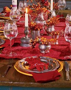 red tablecloth and napkins with red maple leaves for thanksgiving table decoration