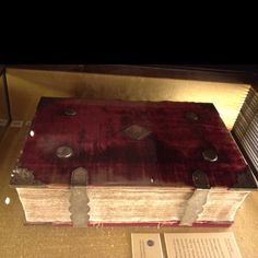 """Queen Elizabeth I's personal Bible. It has a red velvet covering with silver hardware engraved with the English Tudor rose and """"EL RE"""" (Elizabeth Regina)."""